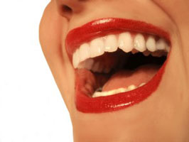 Happy Young Woman with Porcelain Veneers